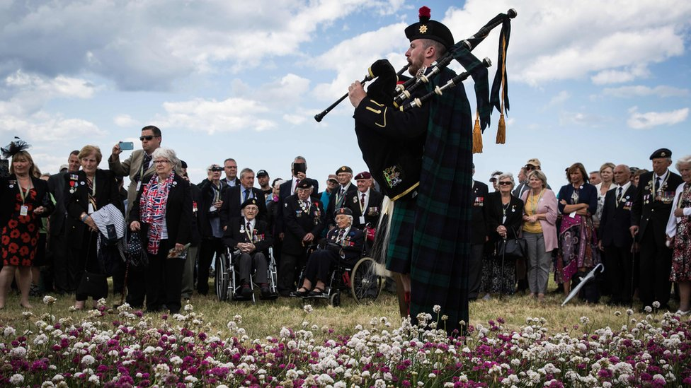 A British soldier played the bagpipes for the inauguration of a garden in Arromanches
