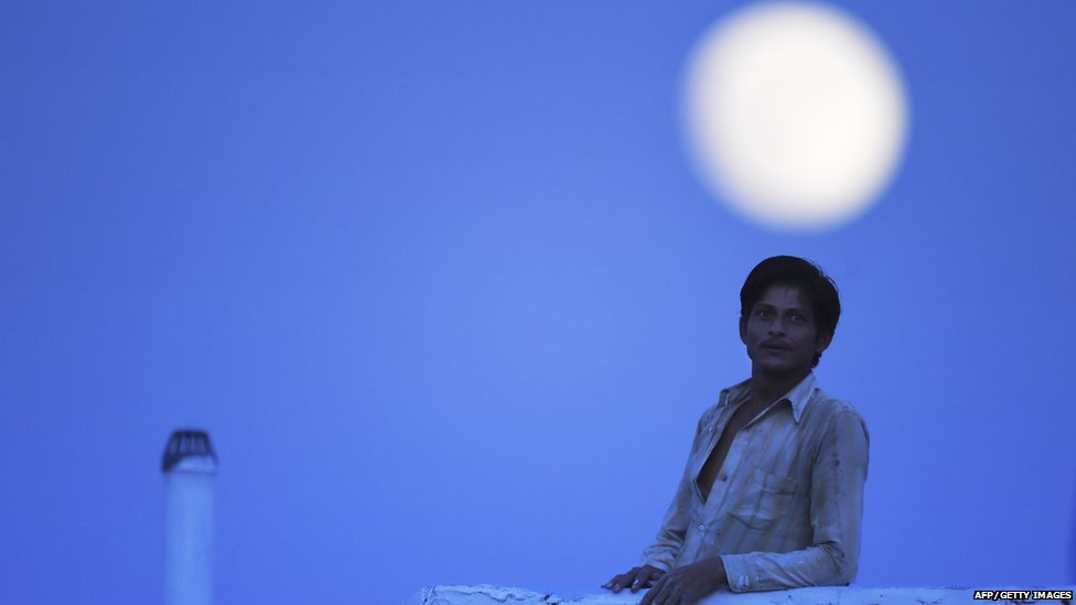 Man with Moon in Background