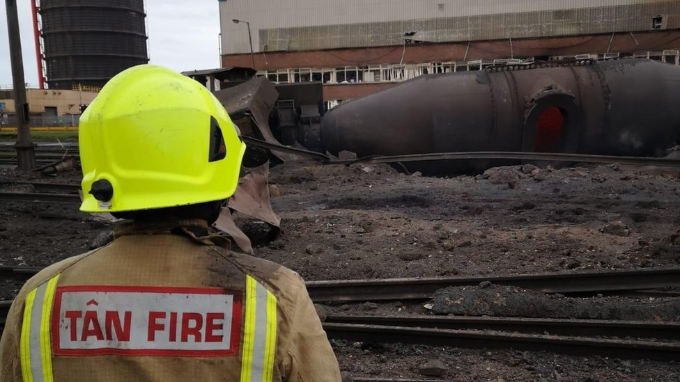 A fireman assesses the damage on the site