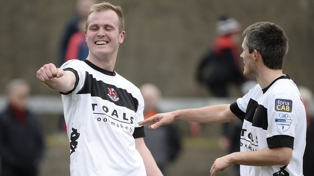 Crusaders players celbrate victory over Carrick Rangers
