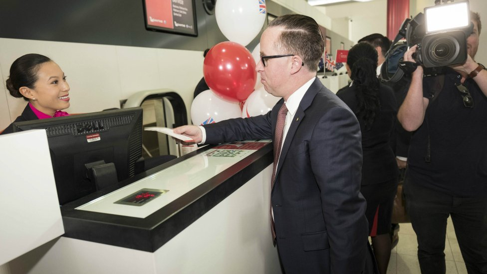 Qantas Chief Executive Alan Joyce at the check-in counter at Perth Airport for the first direct flight to Heathrow airport. 24 March 2018.