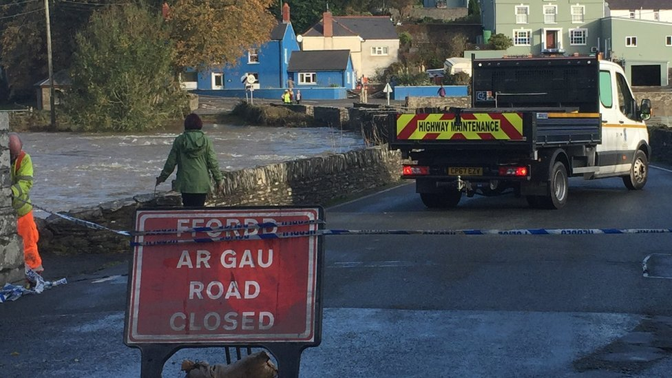 Sign and cordon across the road blocks access to Llechryd Bridge