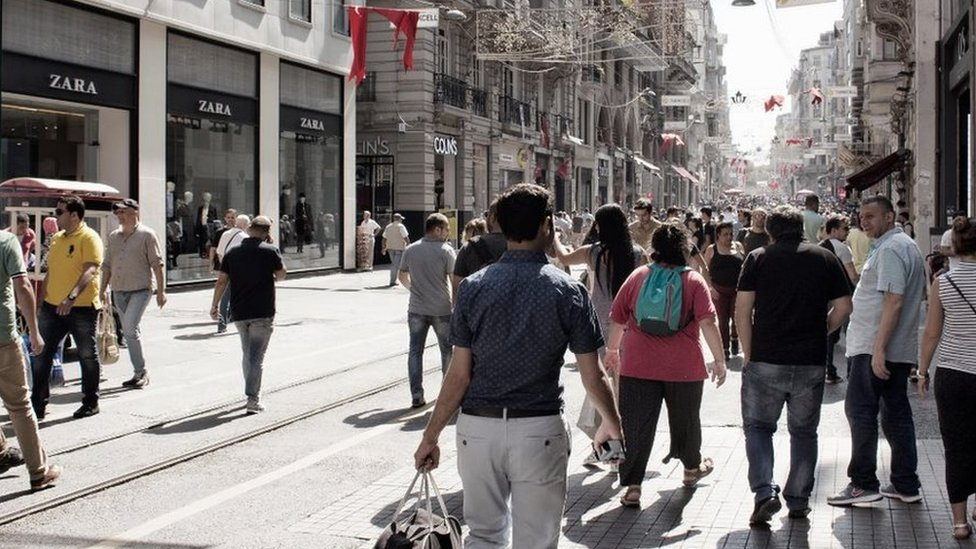 Local people and tourists walk on Istiklal Avenue in Beyoglu Istanbul