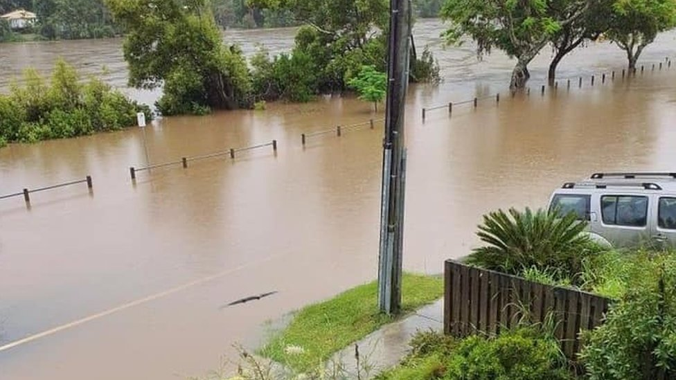 Floodwaters rising next to residential homes in the New South Wales town of Tumbulgum on 15 December 2020