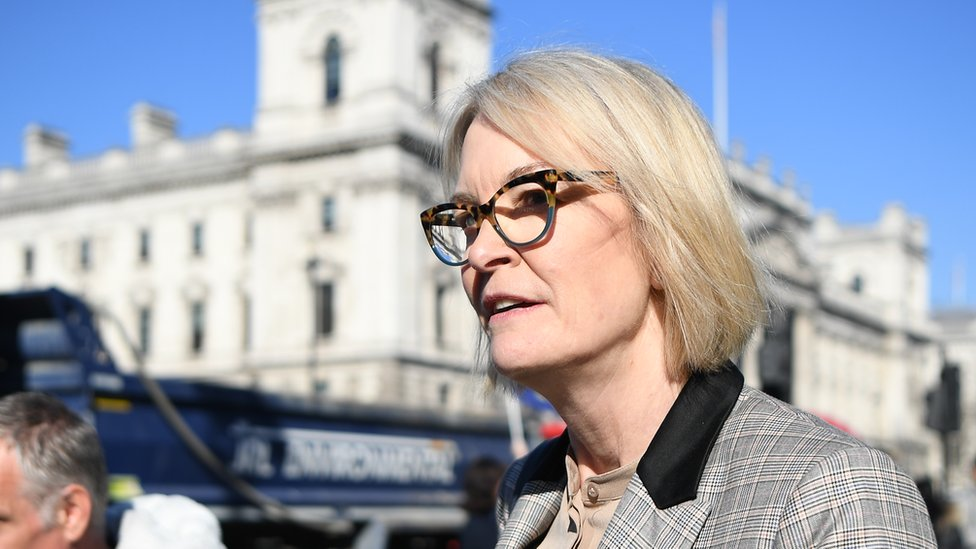 Margot James, standing in the sunshine outside the houses or parliament