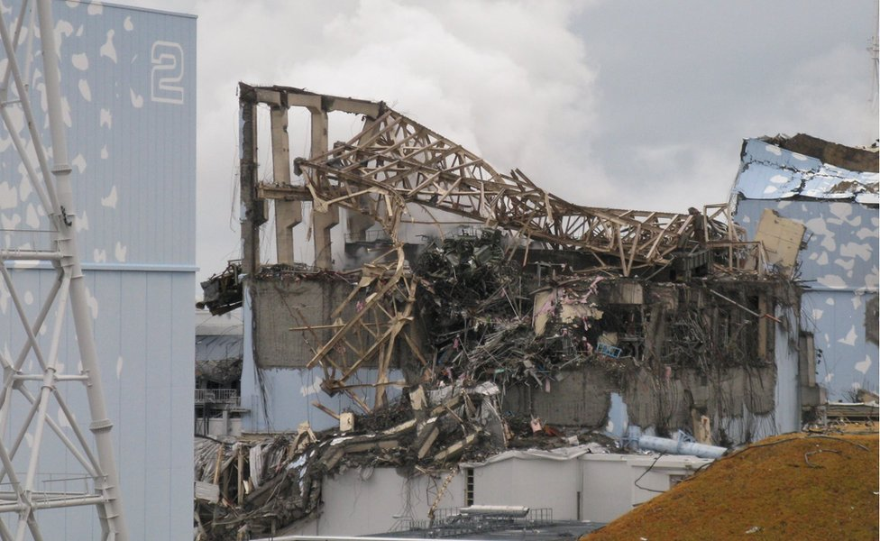 An image from March 2011 of steam billowing from a building after an explosion at the Fukushima Dai-ichi nuclear power plant