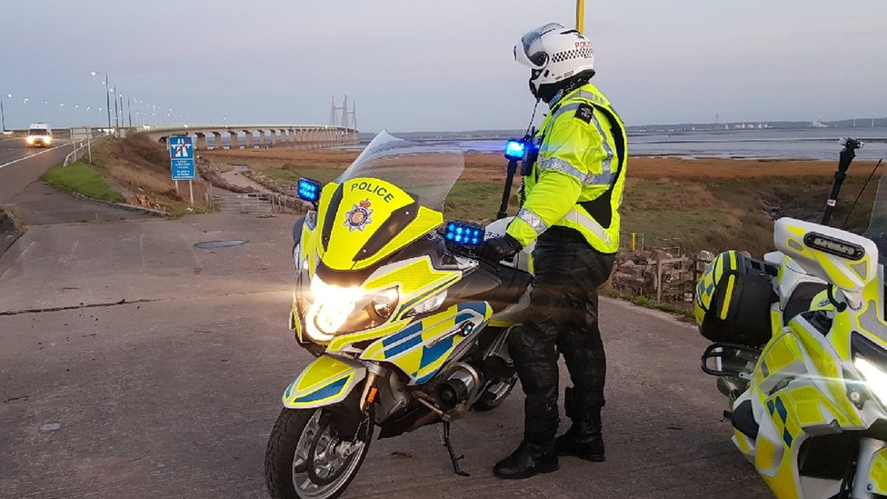 police officer next to motorbike