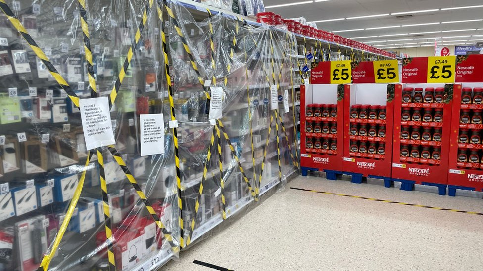 Electrical products taped up in a Tesco store in Penarth, Vale of Glamorgan