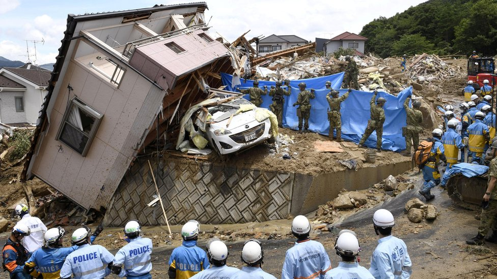Police and Ground Self-Defense Force's rescue workers inspect damage caused by heavy rains in Kumano, Hiroshima Prefecture, Japan, 09 July 2018.