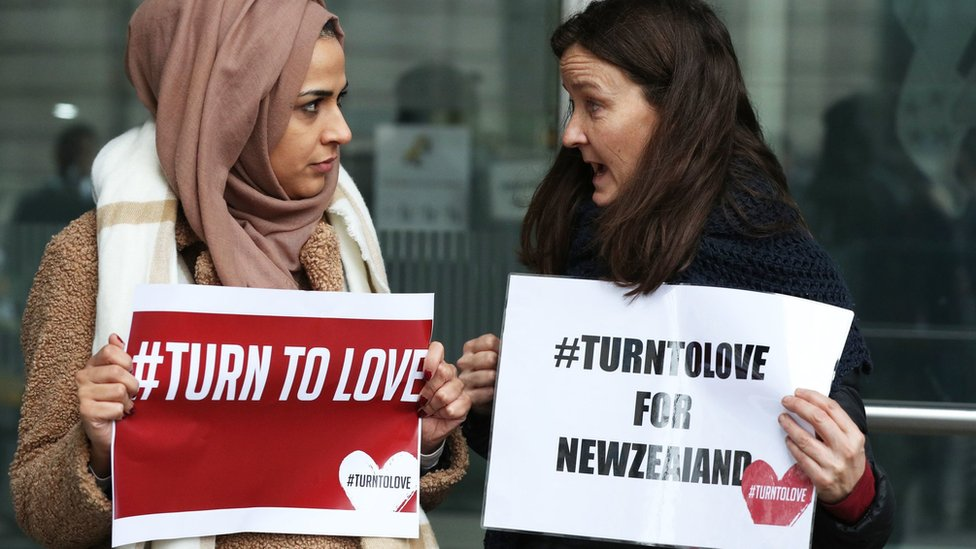 Members of the Turn to Love campaign hold placards outside New Zealand High Commission in Haymarket, London