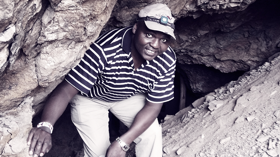 Dr Paul Webala on a field trip, emerging from a bat cave