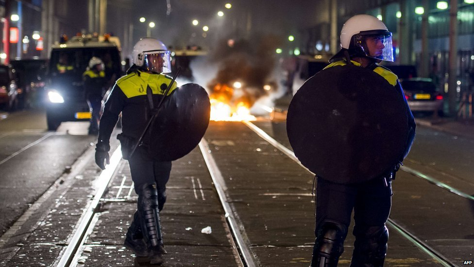Dutch police on duty during a riot in the Schilderswijk district of The Hague