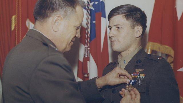 Marine receiving Navy Cross in ceremony