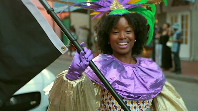 A young black woman dancing in a parade