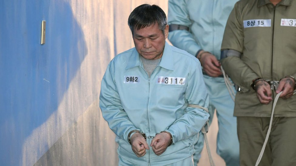 South Korean pastor Lee Jaerock arrives at the Seoul Central District Court to attend his trial in Seoul on November 22, 2018.