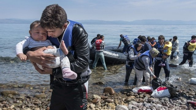 Migrants being helped from the sea in Lesbos