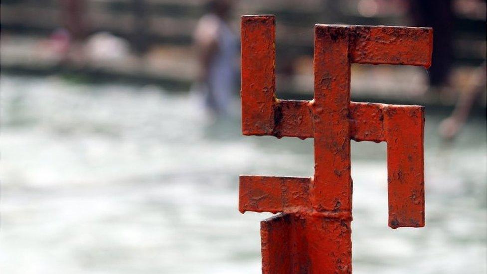 Red swastika cross on the Ganges River at Haridwar, Uttarakhand, India