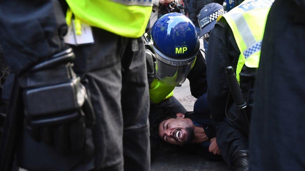 Protester being arrested