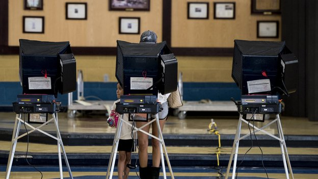 man at electronic voting machine