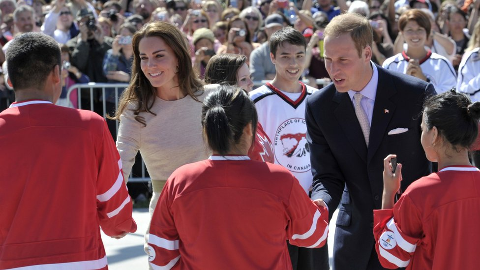 The Duke and Duchess of Cambridge shake hands with ice hockey players during their tour of Canada