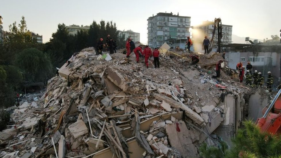 An aerial view shows rescue workers searching for survivors at a collapsed building after an earthquake in the Aegean port city of Izmir, Turkey on 31 October 2020.