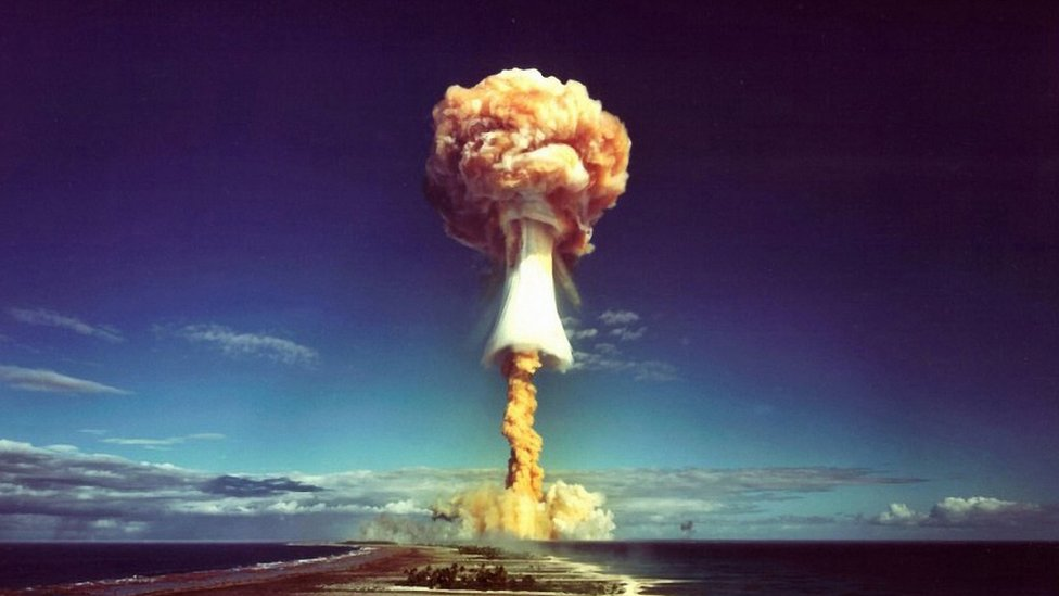 A mushroom cloud after the explosion of a French atomic bomb above the atoll of Mururoa, also known as Aopuni. 1971. From 1966until 1996 this was the French testing ground for 193 bombs which detonated first atmospheric, then underground. French Polynesia, Pacific.
