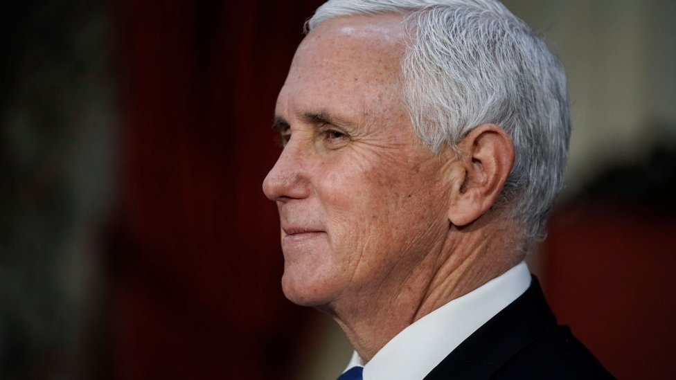 Vice President Mike Pence finishes a swearing-in ceremony for senators in the Old Senate Chamber on Capitol Hill on January 3, 2021