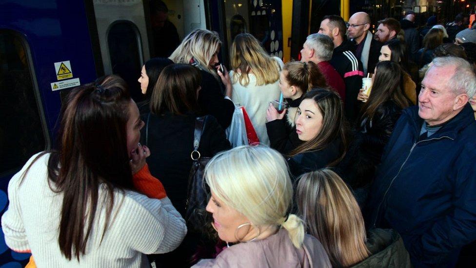 Crowds try to get on train at Edinburgh Waverley