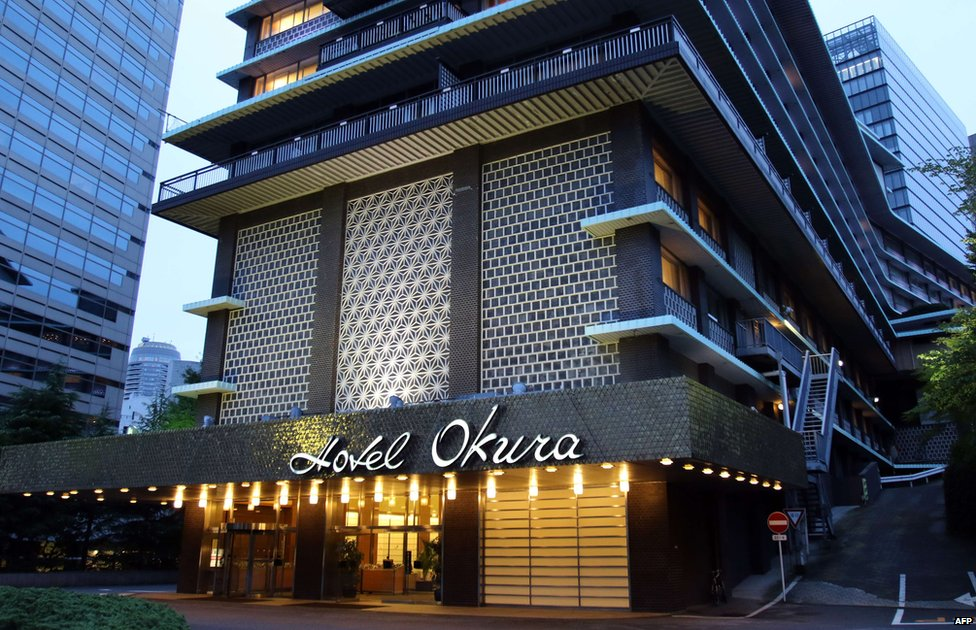 "This picture taken on 29 August 2015 shows an entrance to the main building of Japan""s iconic Hotel Okura in Tokyo."