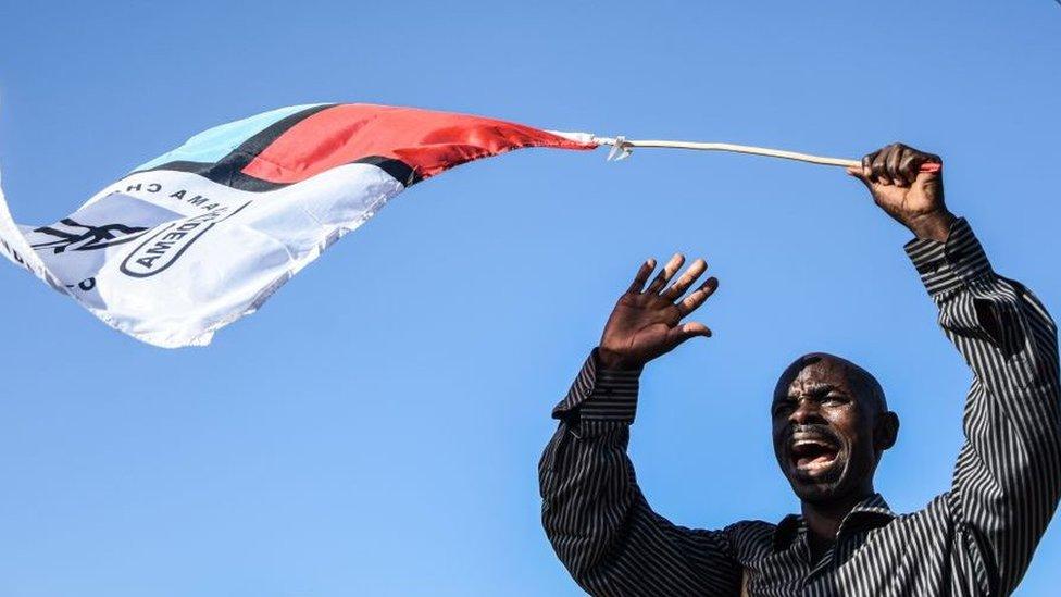 Chadema supporter waving a flag