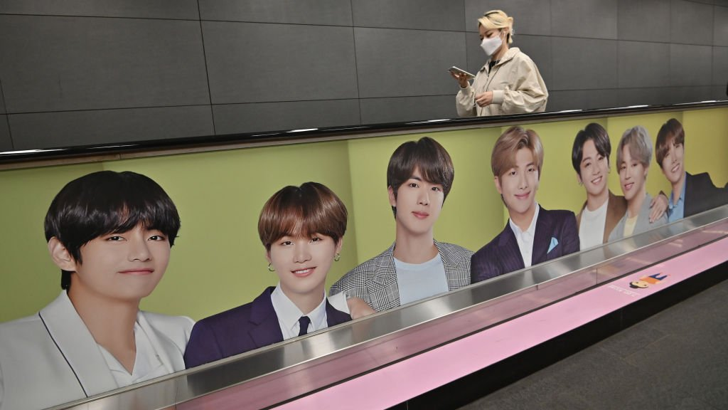 BTS advertising on the side of an escalator.