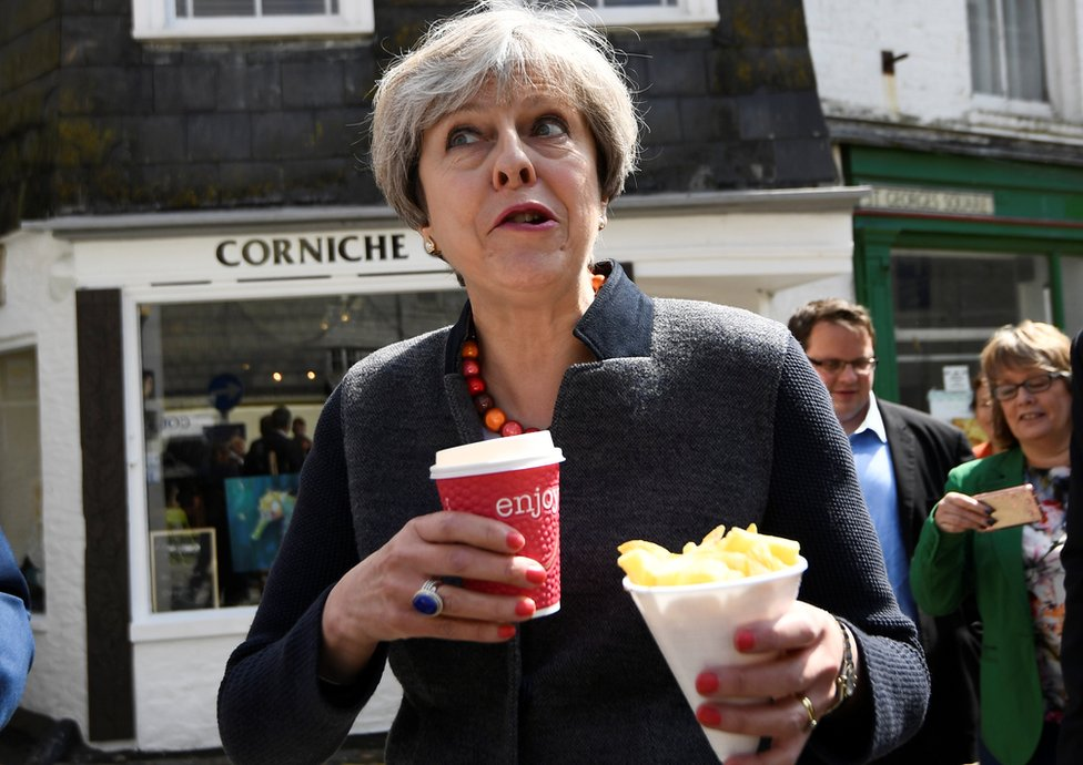 Theresa May eating chips
