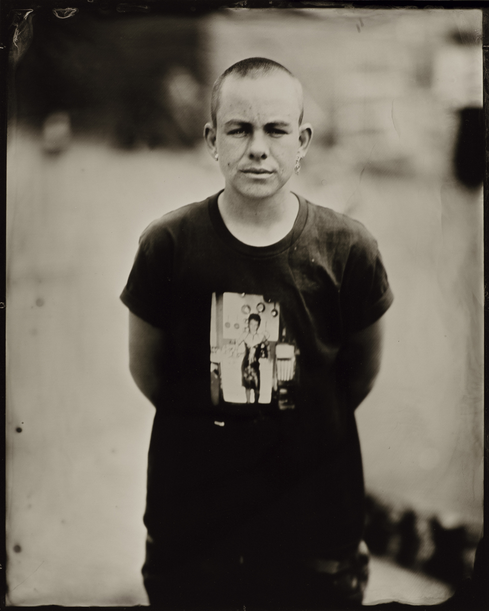 Portrait of a person wearing a dark t-shirt