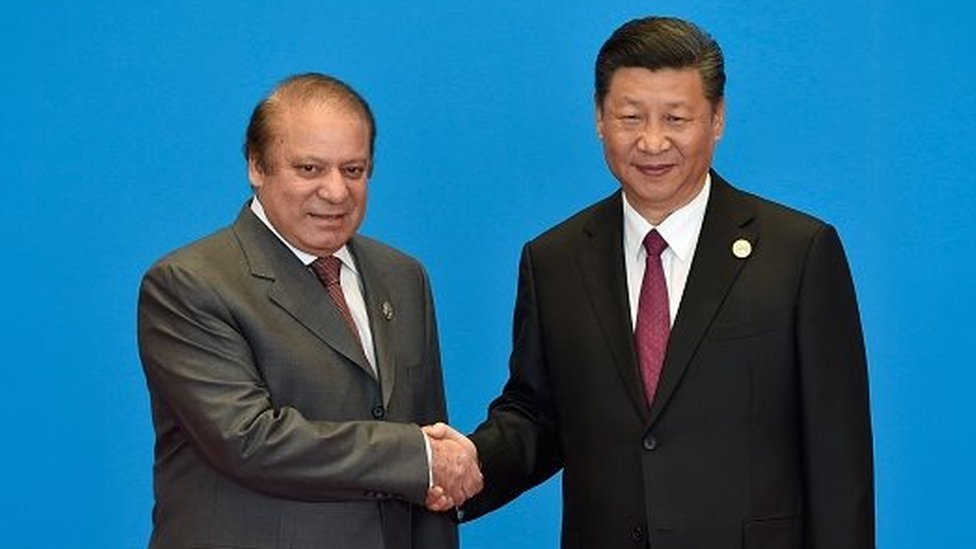 Pakistan's Prime Minister Nawaz Sharif (L) shakes hands with China's President Xi Jinping during the welcome ceremony for the Belt and Road Forum, at the International Conference Center in Yanqi Lake, north of Beijing, on May 15, 2017