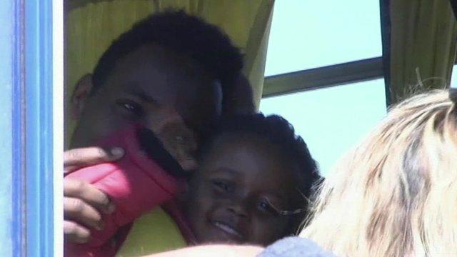 Migrant boy survivor arrives in Greece after sea rescue