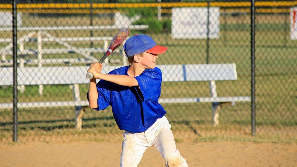 A boy plays baseball