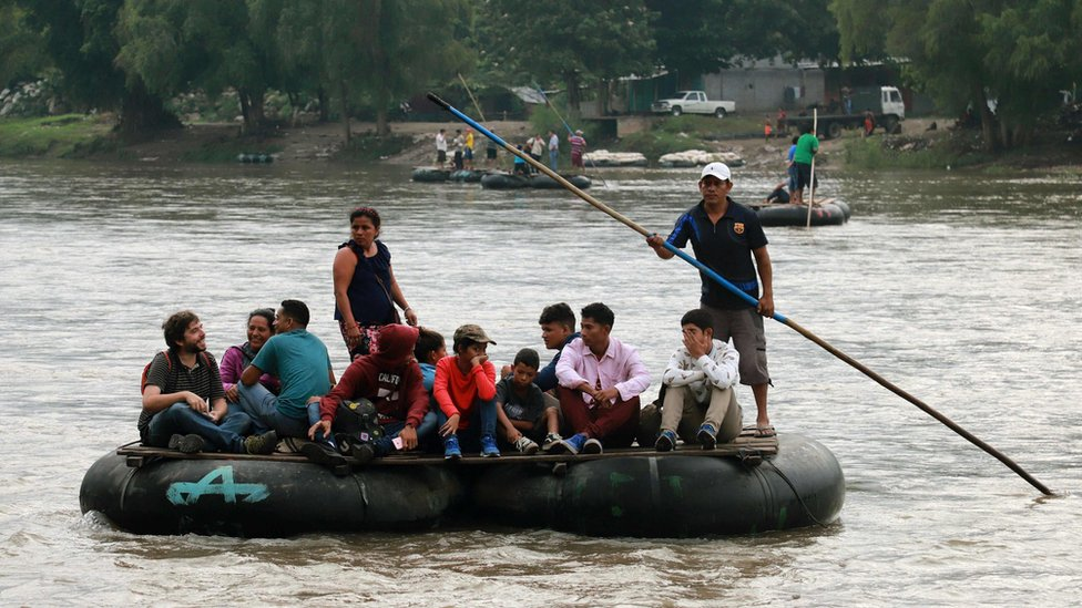 Locals and Central American migrants use a makeshift raft across the Suchiate river from Tecun Uman in Guatemala, to Ciudad Hidalgo in Chiapas State, Mexico, on June 11, 2019