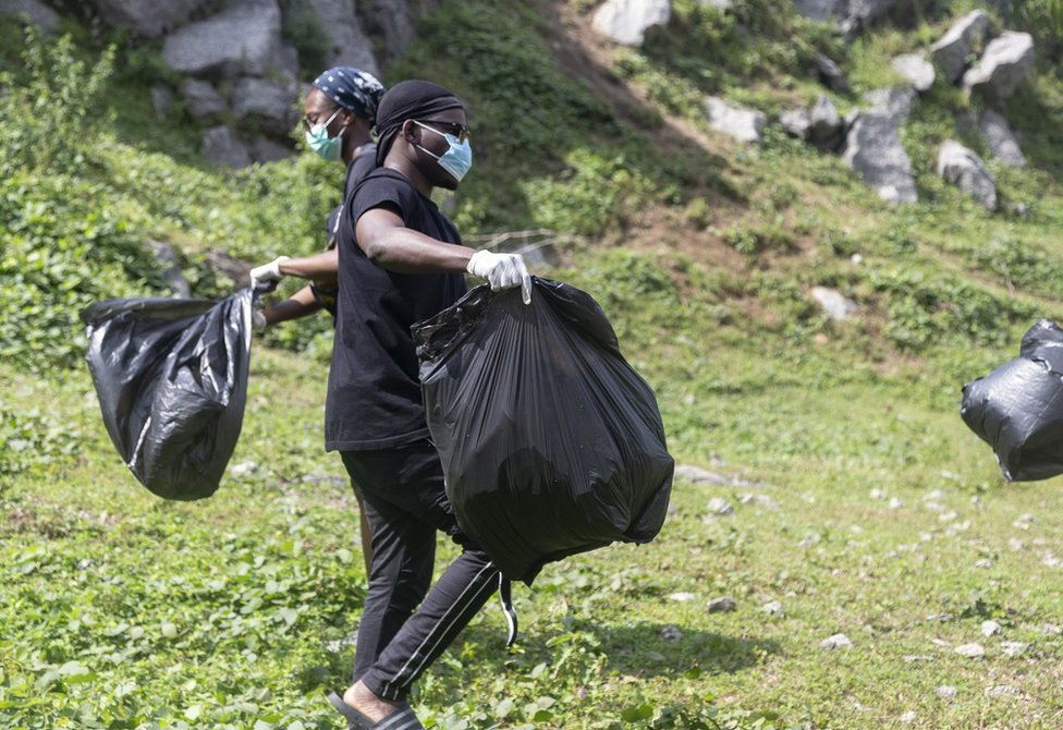 Volunteer cleaners at Mpape Crushed Rock near Abuja, Nigeria