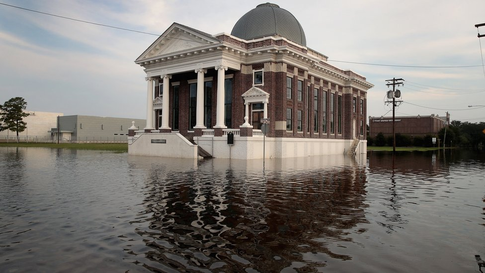 Floodwater surrounds a baptist church in Texas