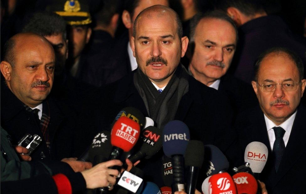 Turkish Minister of the Interior, Suleyman Soylu (centre) speaks to journalists on December 19 after Andrey Karlov, the Russian ambassador to Ankara, was assassinated