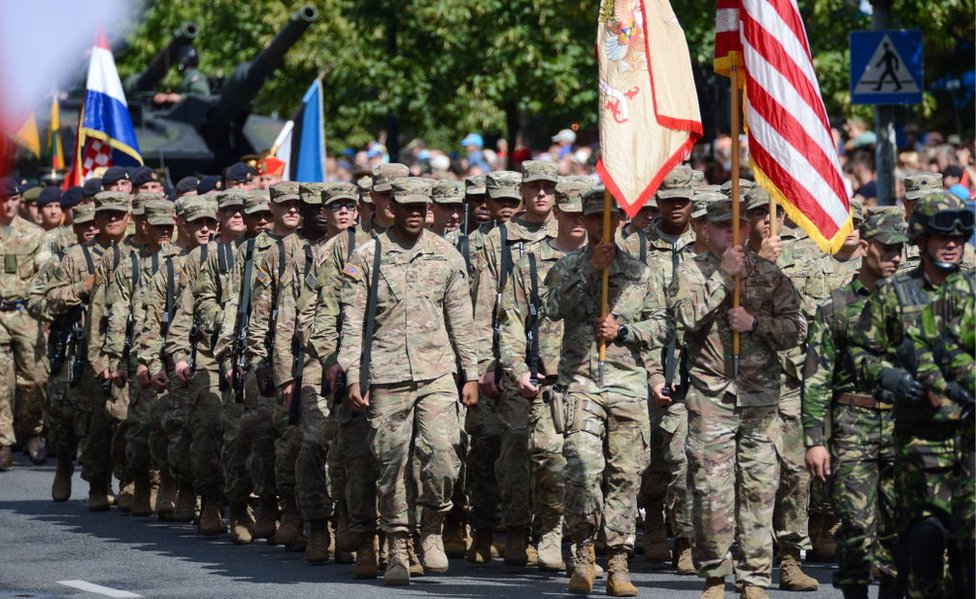 US soldiers march in Warsaw in 2017