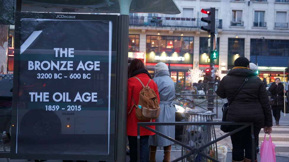 """A poster reading """"The Bronze age - 3200 BC to 600 BC; The Oil age - 1859-2015"""""""