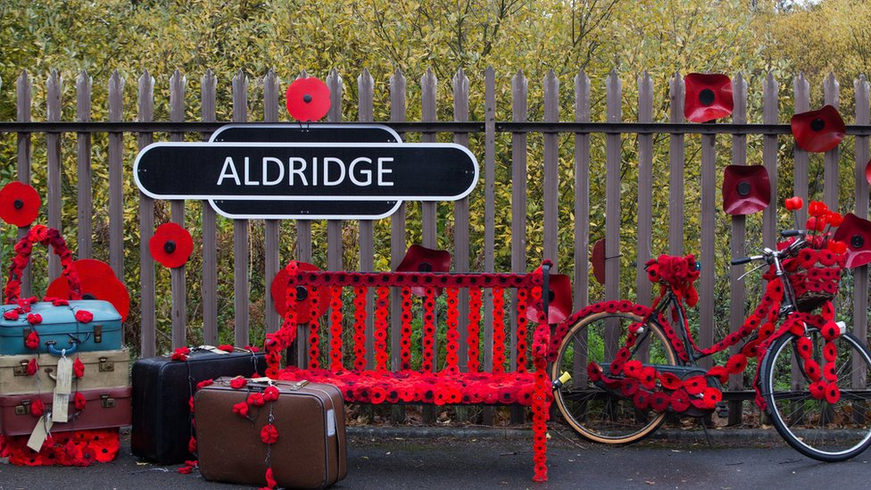 A sign in Station Road, Aldridge in Walsall which has transformed itself into Poppy Road as almost 100 houses have been decorated with 24,000 red poppies and silhouette statues of soldiers to honour local people
