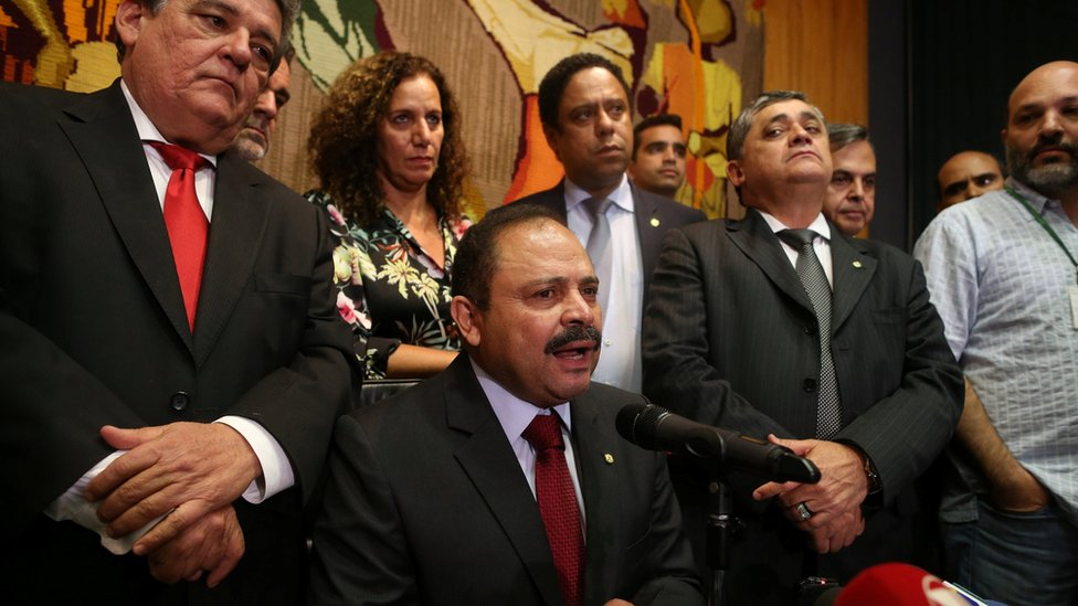 Waldir Maranhao at a press conference, surrounded by people. May 9, 2016.