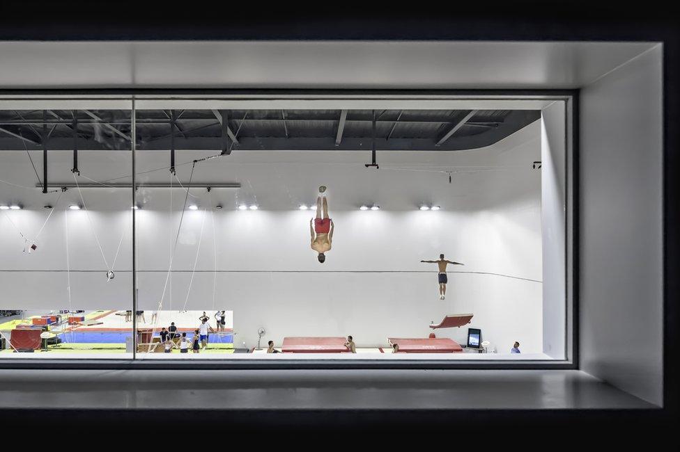 Athletes performing acrobatics on trampolines