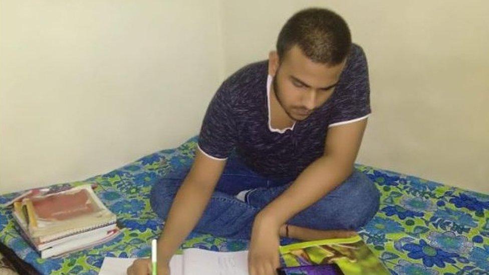 Kumar reading at his home