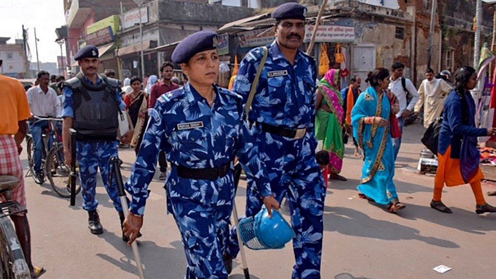 Rapid Action Force (RPF) personnel patrol on a street in Ayodhya on November 8, 2019