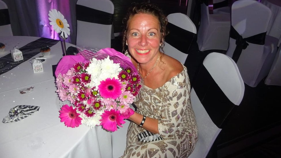 Sarah Griffiths at the school prom with the flowers she was given.