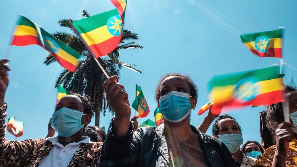 People waving the national flag near the prime minister's office in Addis Ababa