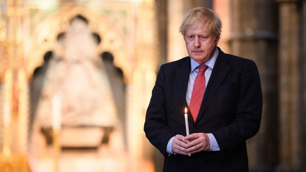 Prime Minister Boris Johnson prepares to light a candle at the Grave of the Unknown Warrior in Westminster Abbey in London, ahead of commemorations to mark the 75th anniversary of VE Day